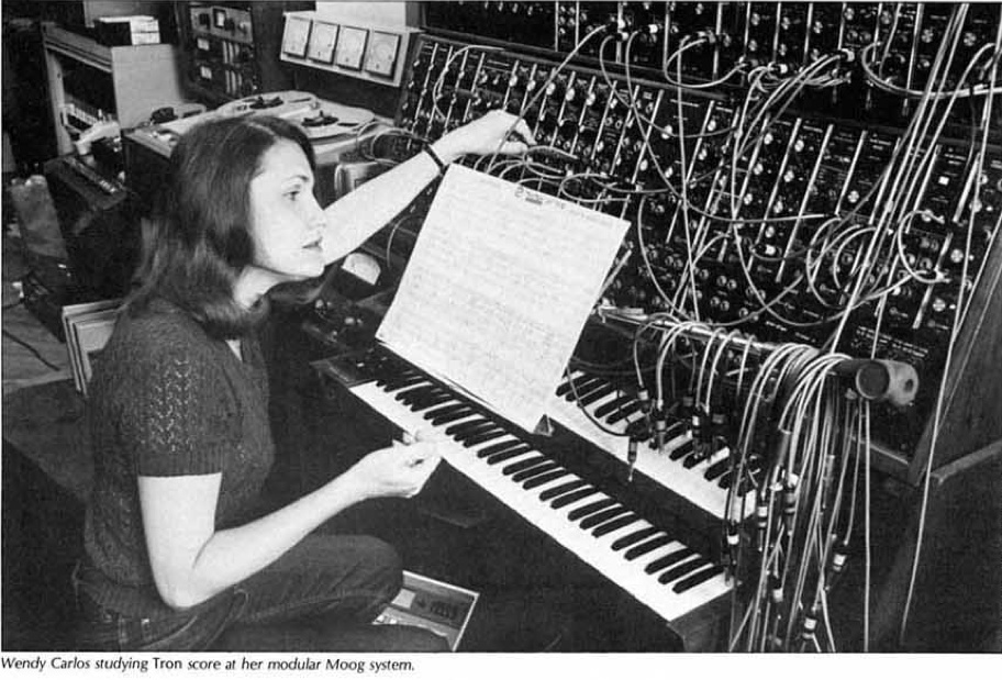 Wendy Carlos studying the score to Tron at her modular Moog system.