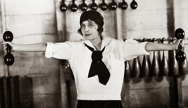 1920s --- Woman Exercising with Dumbells --- Image by © Bettmann/CORBIS